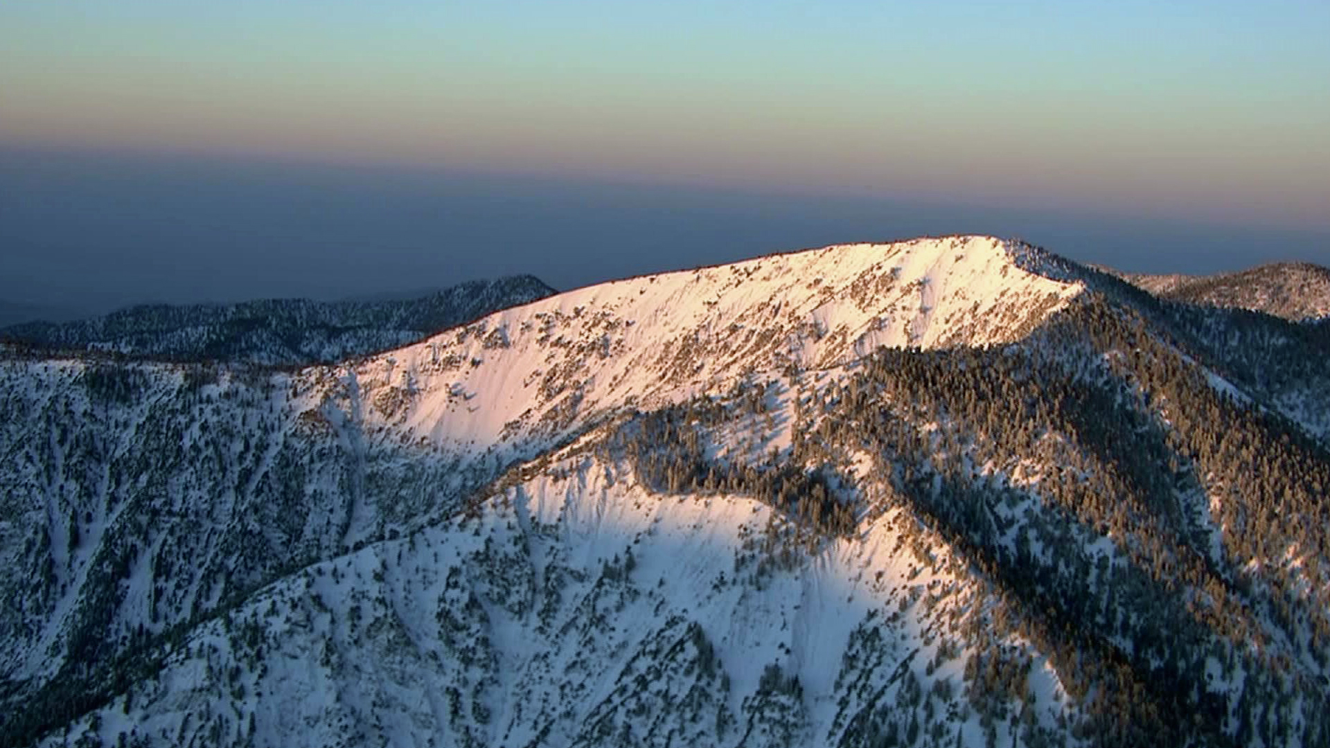 A file photo shows snow in the mountains of Southern California.