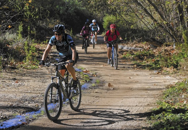 Bicyclists take off on a morning ride through Whiting Ranch Wilderness Park on Feb. 14, 2014. (Mark Boster / Los Angeles Times)