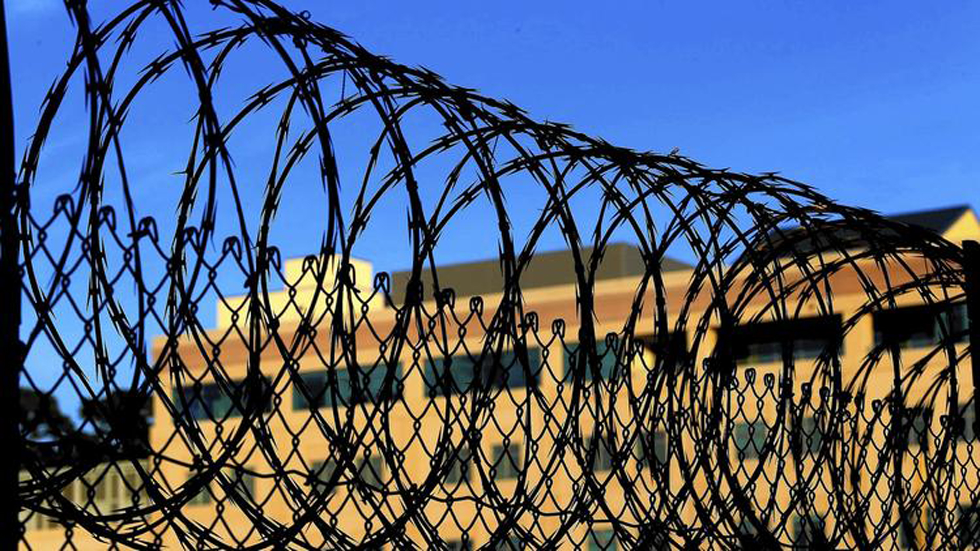Razor wire encircles the exercise yard at San Quentin. Federal courts have ruled that it is unconstitutional to execute people who are not aware of what is happening to them. Some analysts see irony in providing for the long-term mental health of those sentenced to die. (Los Angeles Times)