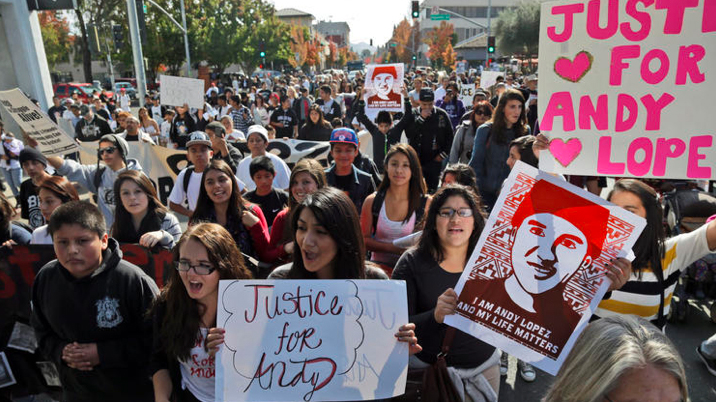 Hundreds of people in Santa Rosa marched to protest the fatal shooting of 13-year-old Andy Lopez by a Northern California sheriff's deputy in 2013. (Credit: Associated Press)