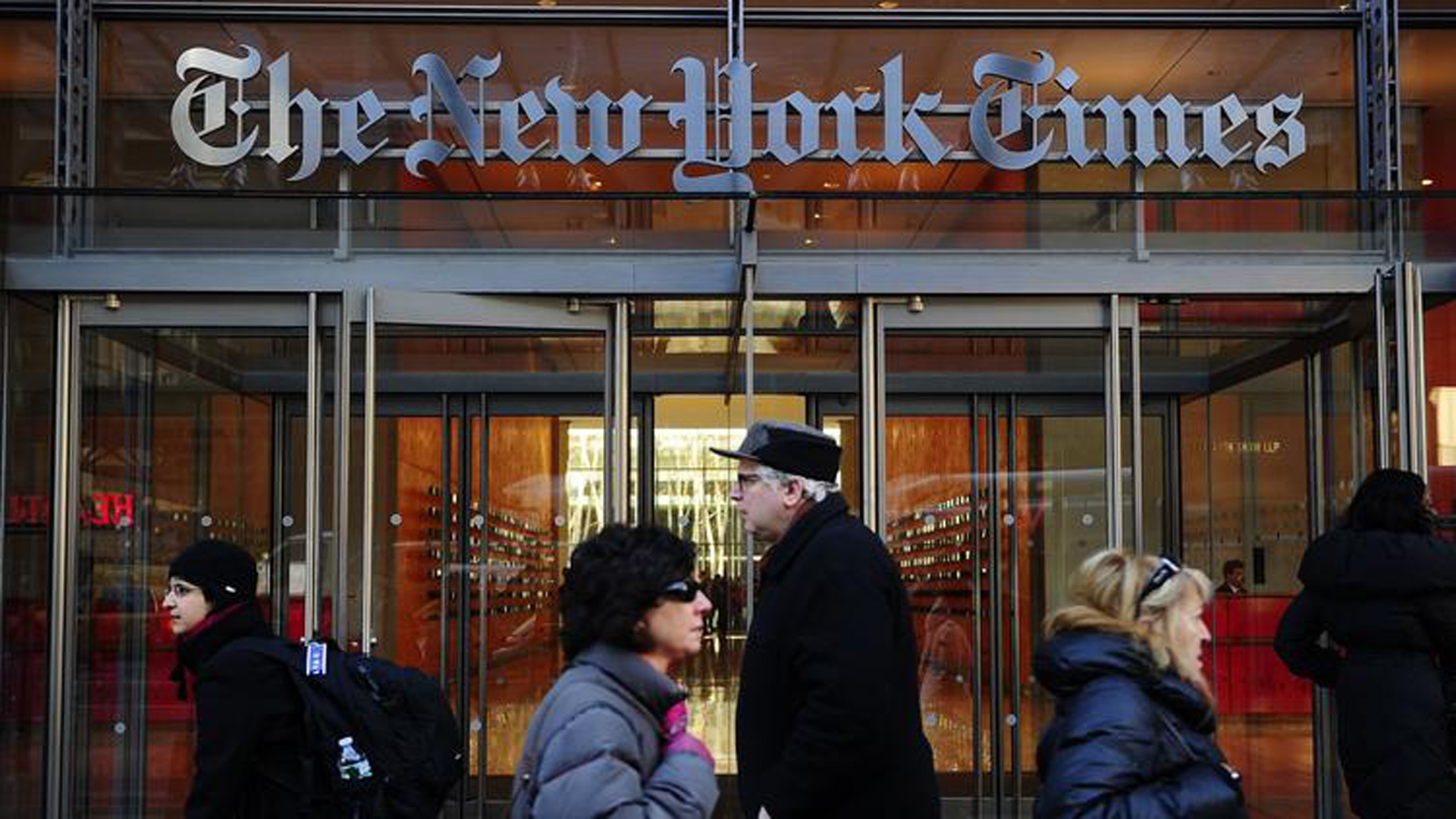 People walk by an entrance to the New York Times on March 8, 2011. (Los Angeles Times)