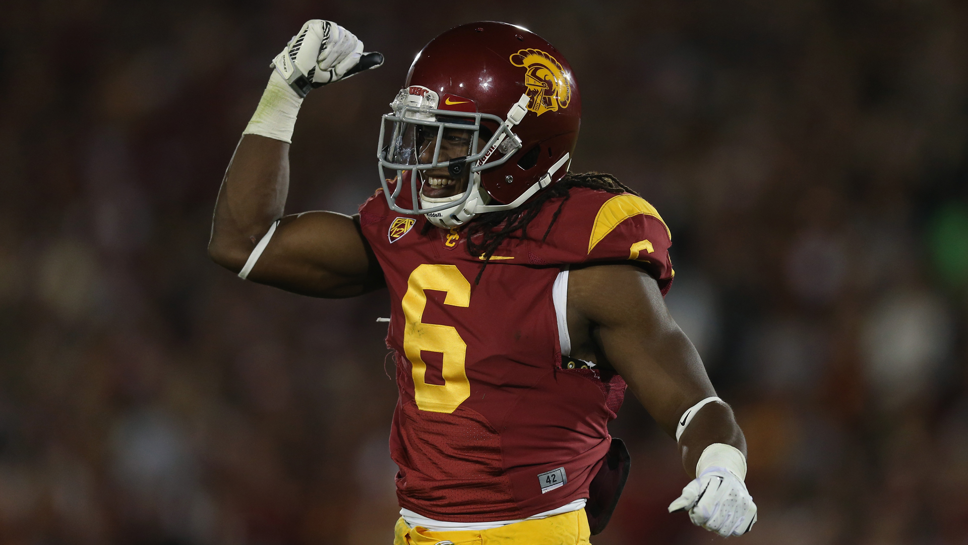 Safety Josh Shaw of the USC Trojans celebrates against the Stanford Cardinal at Los Angeles Coliseum on Saturday, Nov. 16, 2013. (Credit: Jeff Gross/Getty Images)