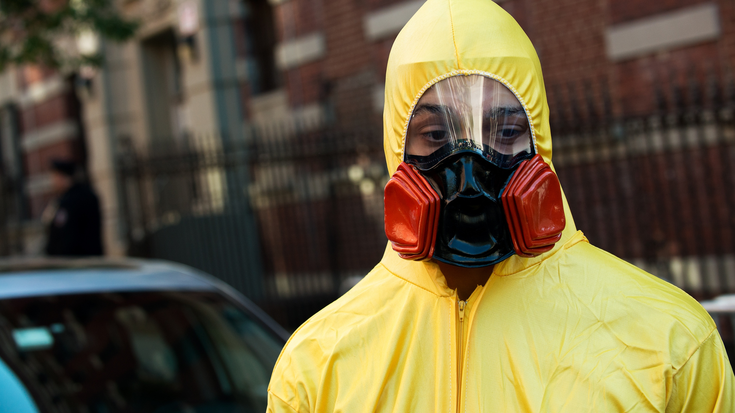 A young man, dressed in a biohazard costume, stands on the corner of 546 West 147th Street on Saturday, Oct. 25, 2014, in New York City. (Credit: Bryan Thomas/Getty Images)