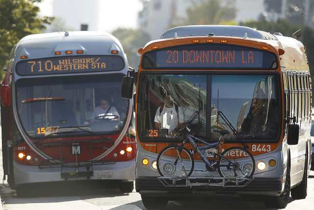 File photo of two Metro buses at Wilshire Boulevard and Western Avenue. (Credit: Robert Gauthier / Los Angeles Times)