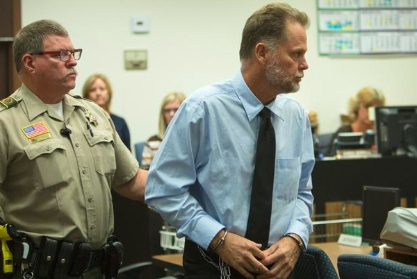 Charles Merritt was led out of the courtroom after his arraignment, where he pleaded not guilty in the slayings of the McStay family. (Credit: Los Angeles Times)