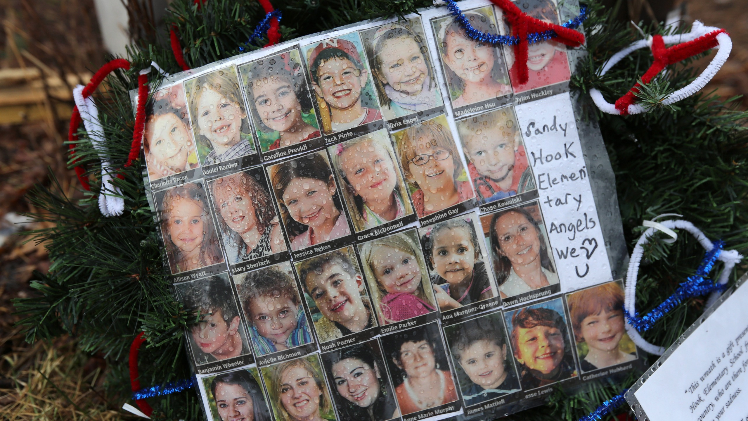Photos of Sandy Hook Elementary School massacre victims sits at a small memorial near the school on Monday, Jan. 14, 2013, in Newtown, Connecticut. (Credit: John Moore/Getty Images)