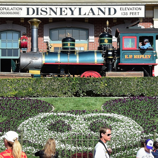 People visit Disneyland on January 22, 2015 in Anaheim, California. (Credit: Frederic J. Brown/AFP/Getty Images)
