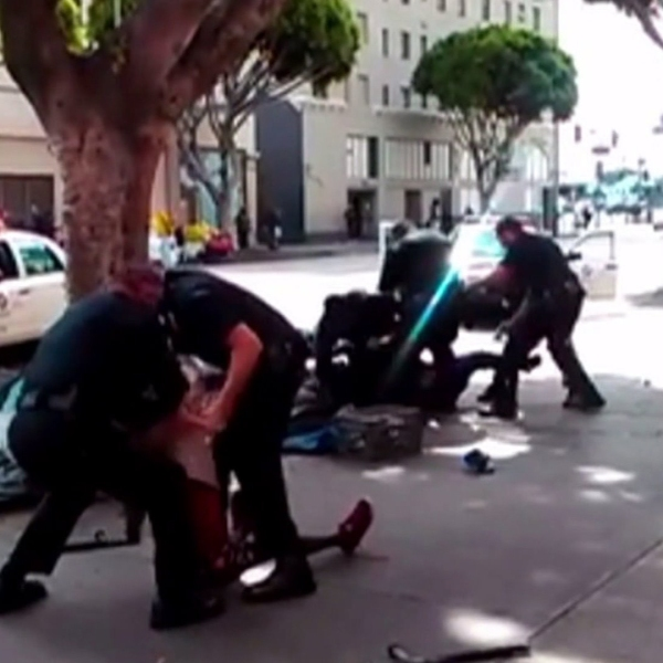 A screenshot from a bystander's video show Los Angeles police officers struggling with a man moments before he was fatally shot in downtown on Sunday, March 1, 2015. (Credit: Anthony Blackburn/via Facebook)