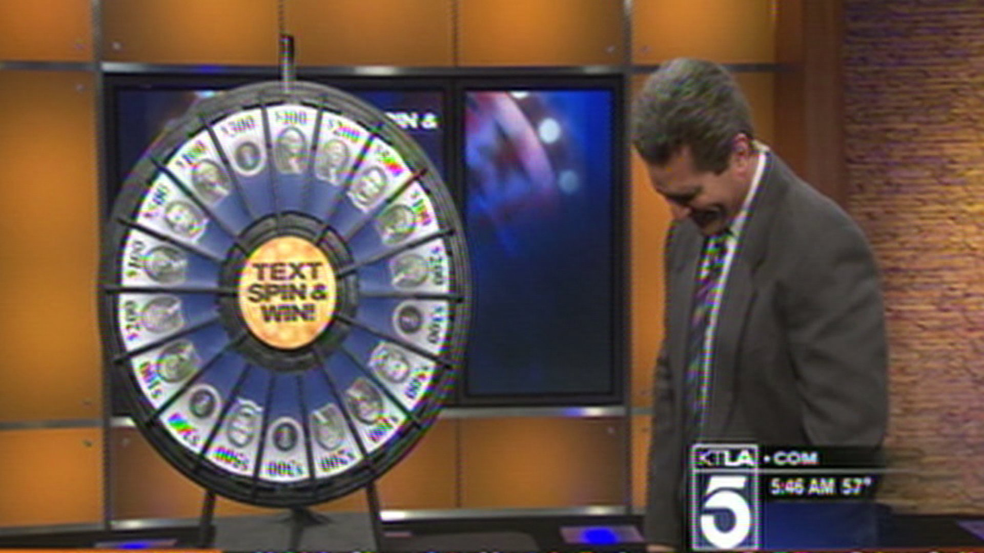 AMS Meteorologist Henry DiCarlo spins another $100, the smallest prize value on KTLA's Spin-to-Win whell. (Credit: KTLA)