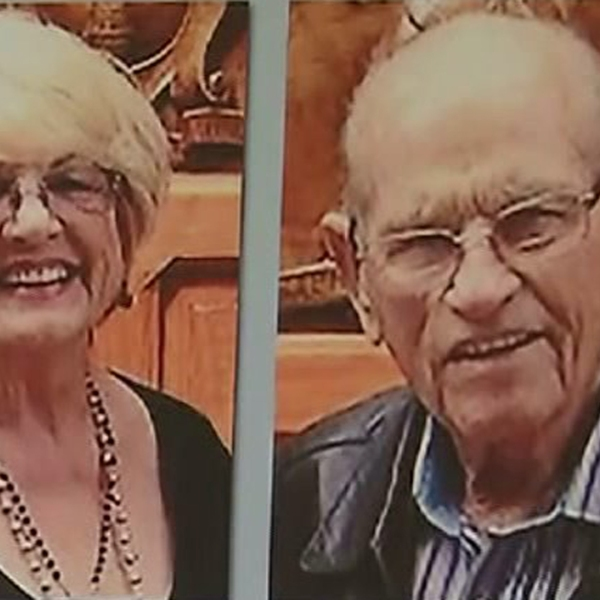 """Shirley and Troy Isom are seen in photos on an """"Information Wanted"""" poster displayed by the L.A. County Sheriff's Department at a May 6, 2015 news conference. (Credit: KTLA)"""