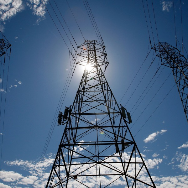 The sun shines over towers carrying electrical lines in South San Francisco in 2007. (Justin Sullivan/Getty Images)