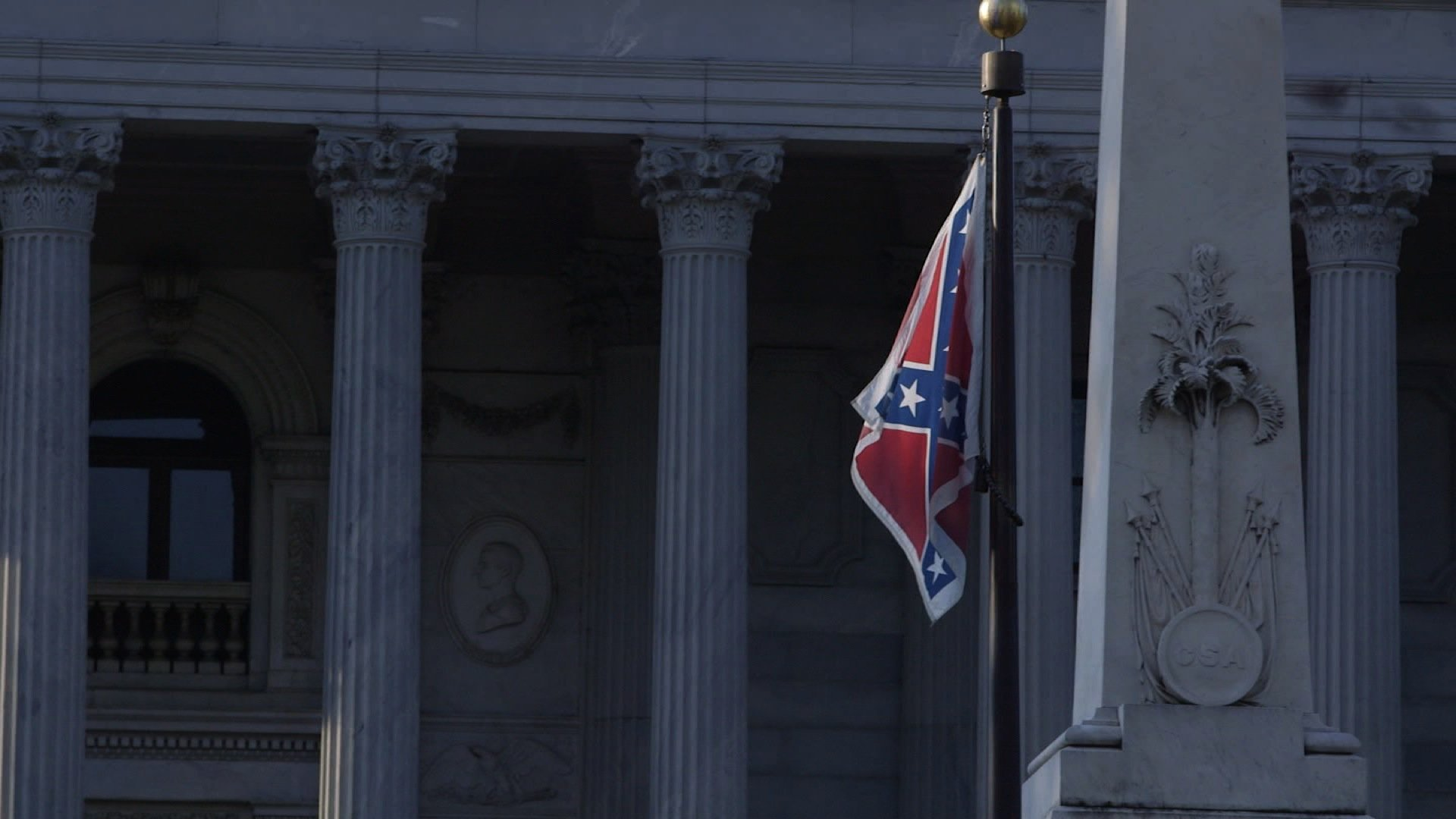 The Confederate battle flag flies near the South Carolina State Capitol building in Columbia in this file image. (Credit: CNN)