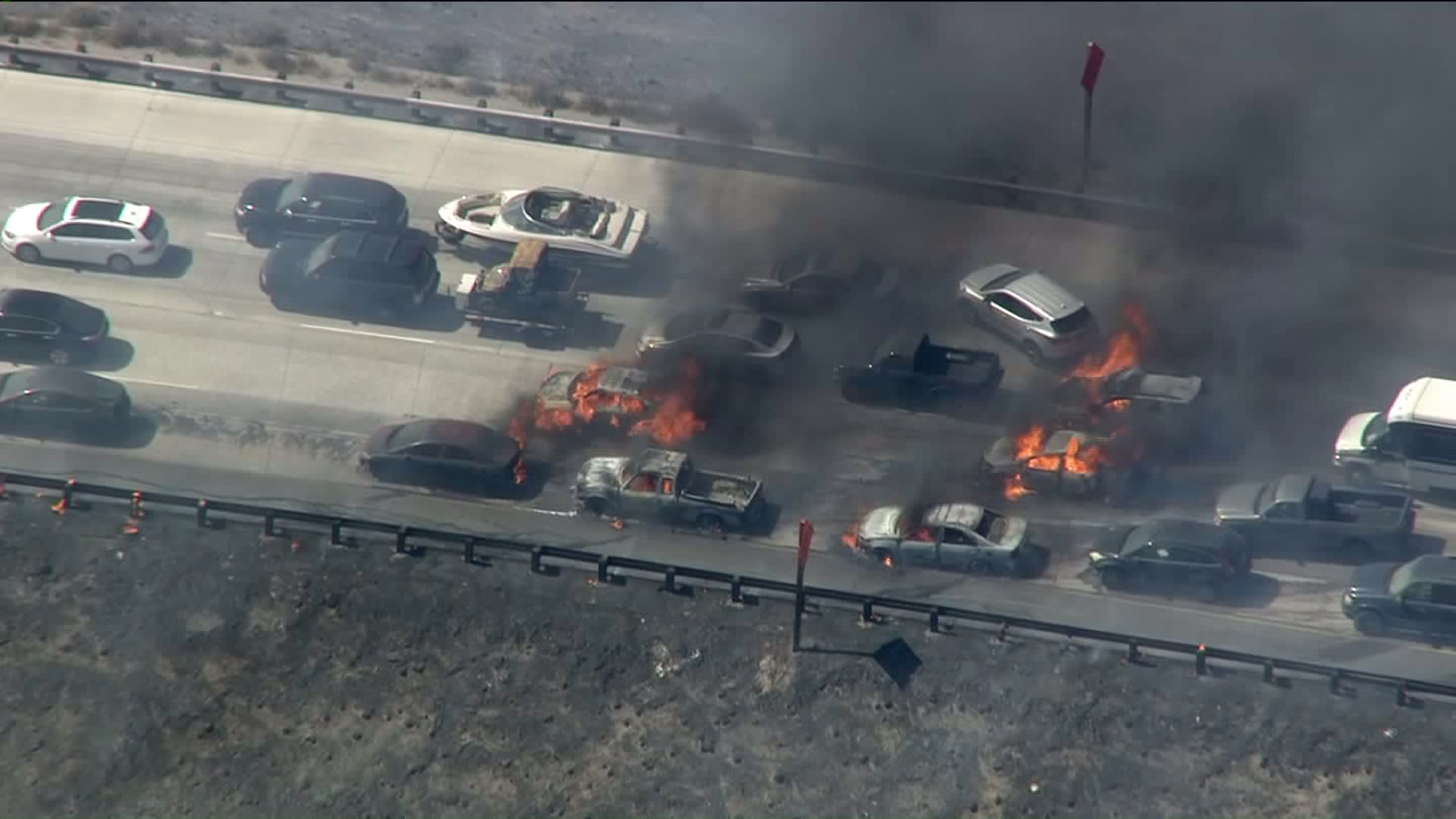 A rapid-moving wildfire on Friday, July 17, 2015, in the Cajon Pass spread from vegetation to vehicles stopped on the 15 Freeway. (Credit: KTLA)