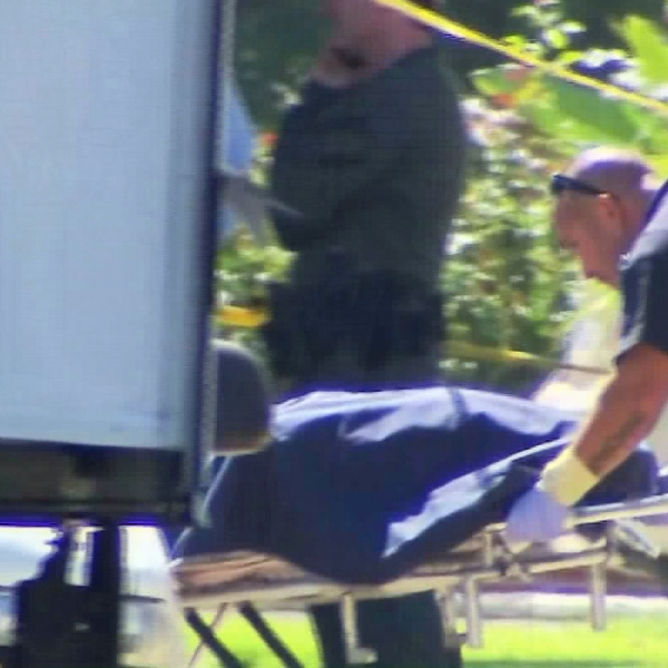 A woman's body was wheeled out of a Burbank home on Aug. 24, 2015. (Credit: KTLA)