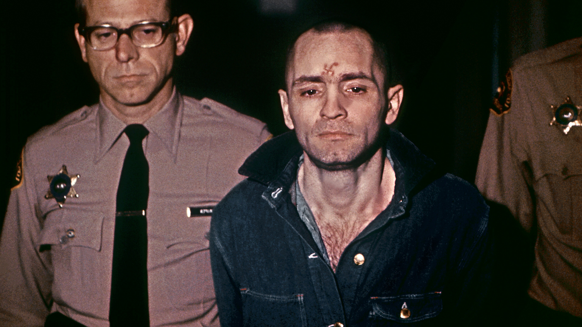 Beardless and shaven-headed, Charles Manson, is sullen faced as he goes to hear sentence of death in the gas chamber passed by the court March 29, 1971, in Los Angeles. Manson was convicted of murder, after in August 1969, during two bloody evenings of paranoid, psychedelic savagery, at least nine people were murdered among them Sharon Tate, the young and pregnant actress and wife of Roman Polanski. The trial of Manson and three girls followers similarly sentenced lasted ten months. (Credit: AFP/Getty Images)