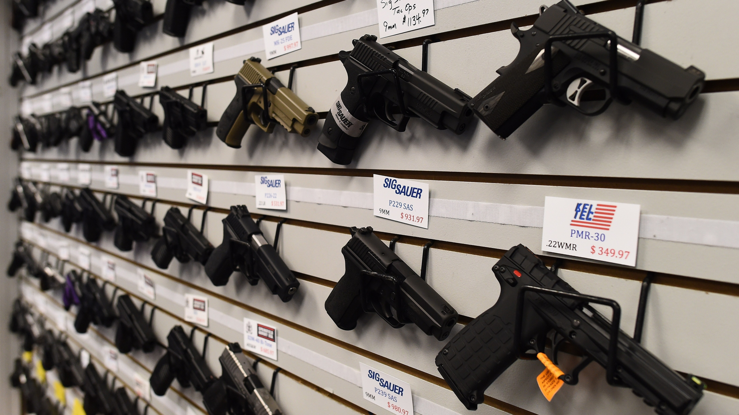 Handguns are displayed at the Ultimate Defense Firing Range and Training Center in St. Peters, Missouri, in November 2014. (JEWEL SAMAD/AFP/Getty Images)