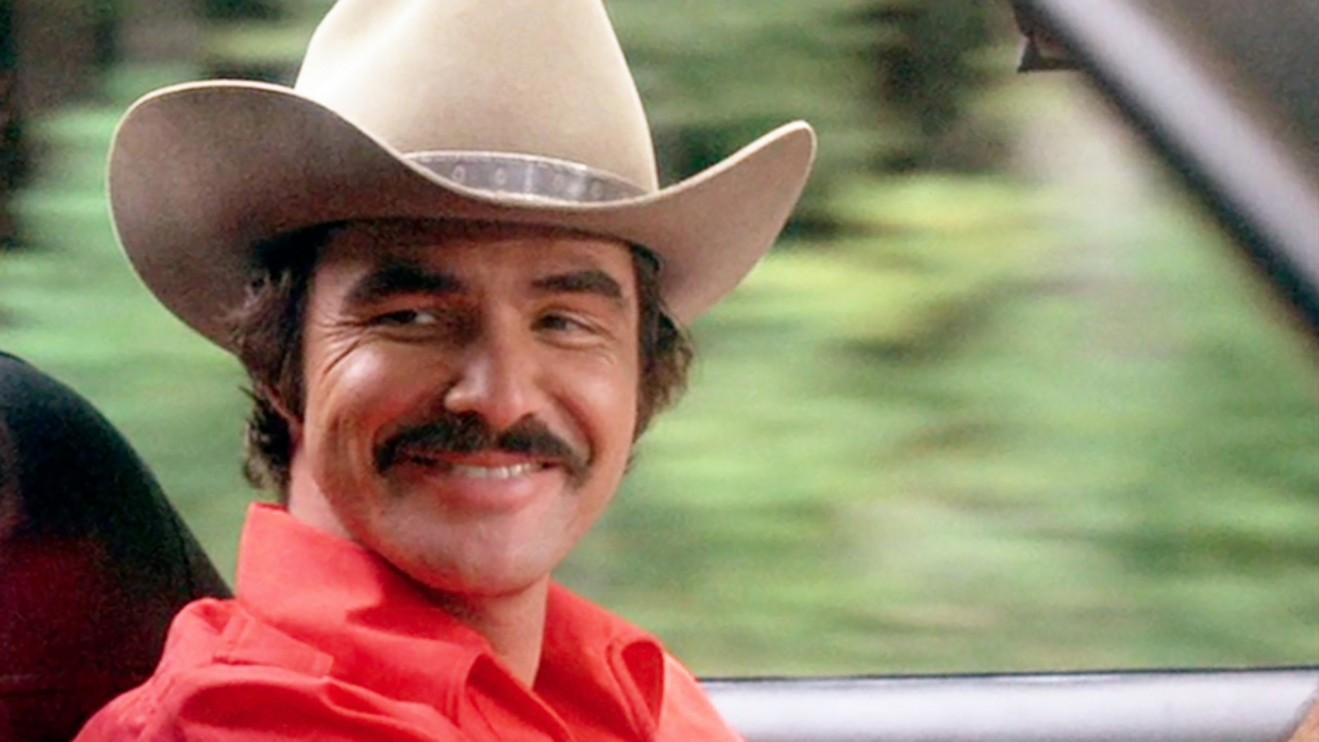 "Actor Burt Reynolds is pictured in a scene from ""Smokey and the Bandit."""