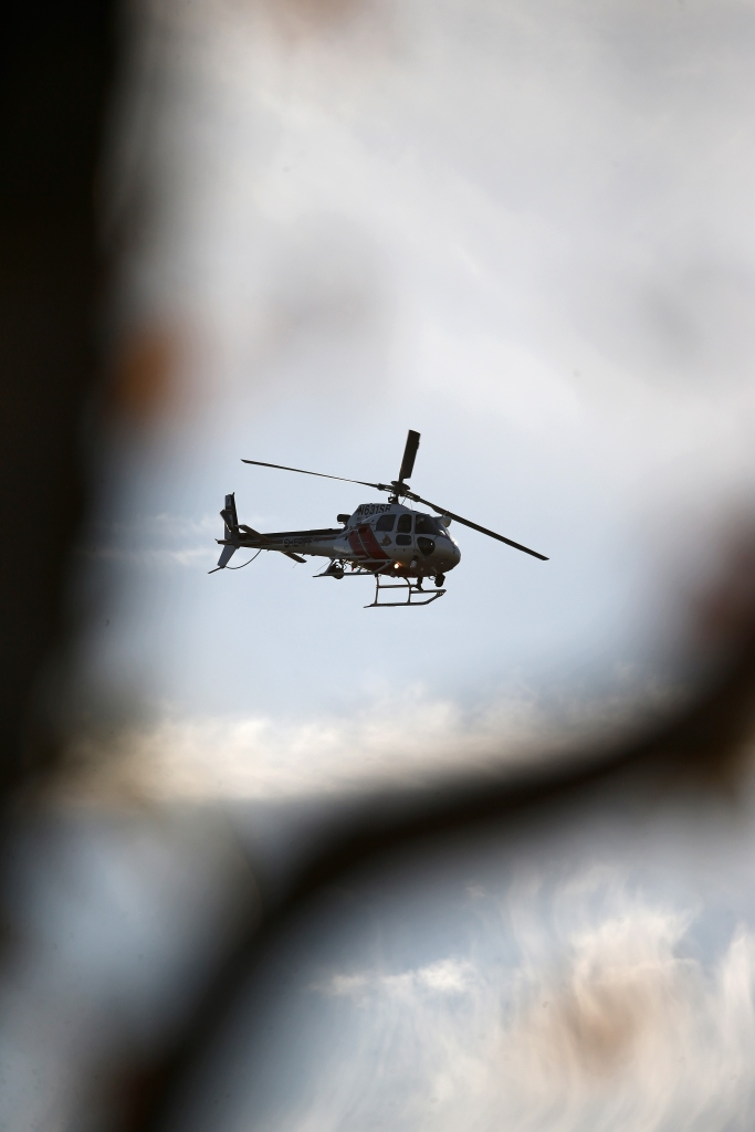 A San Bernardino Sheriff's Department helicopter flies above a neighborhood as authorities pursue suspects of the shooting at the Inland Regional Center on Dec. 2, 2015, in San Bernardino, California. (Credit: Sean M. Haffey/Getty Images)