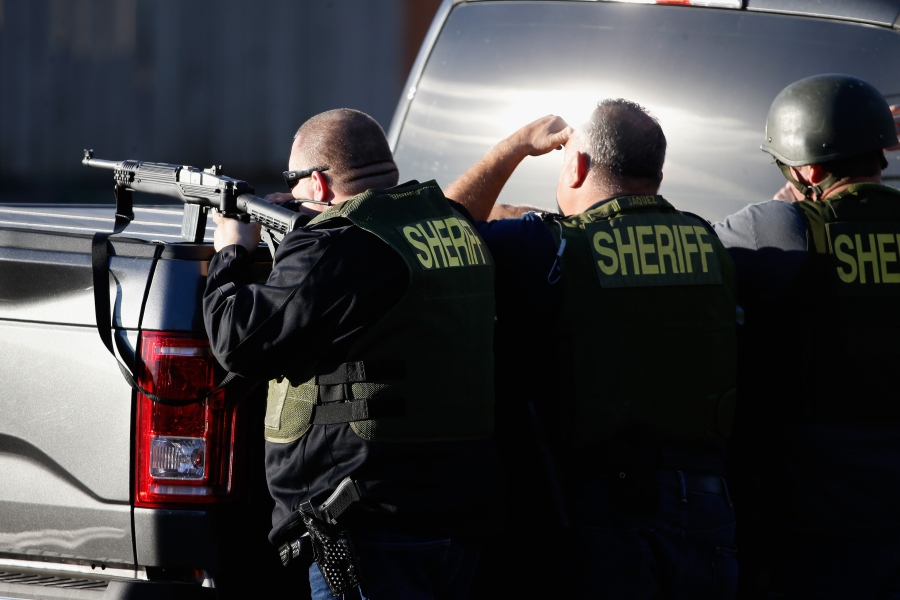 Three people donning Sheriff's Department gear are seen following a mass shooting on Dec. 2, 2015. (Credit: Getty Images)