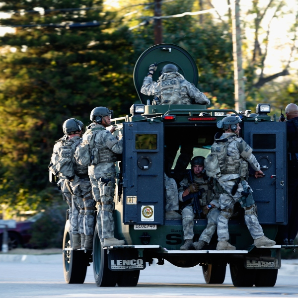 SWAT officers enter an area where suspects were believed to be after the shooting at the Inland Regional Center on Dec. 2, 2015, in San Bernardino, California. (Credit: Sean M. Haffey/Getty Images)
