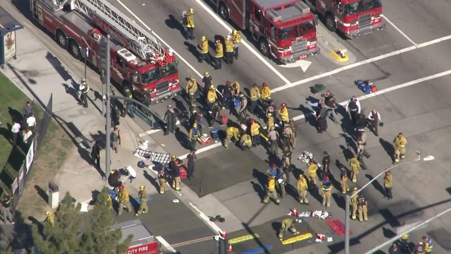 Firefighters set up triage areas in response to an active shooter incident in San Bernardino on Dec. 2, 2015. (Credit: KTLA)