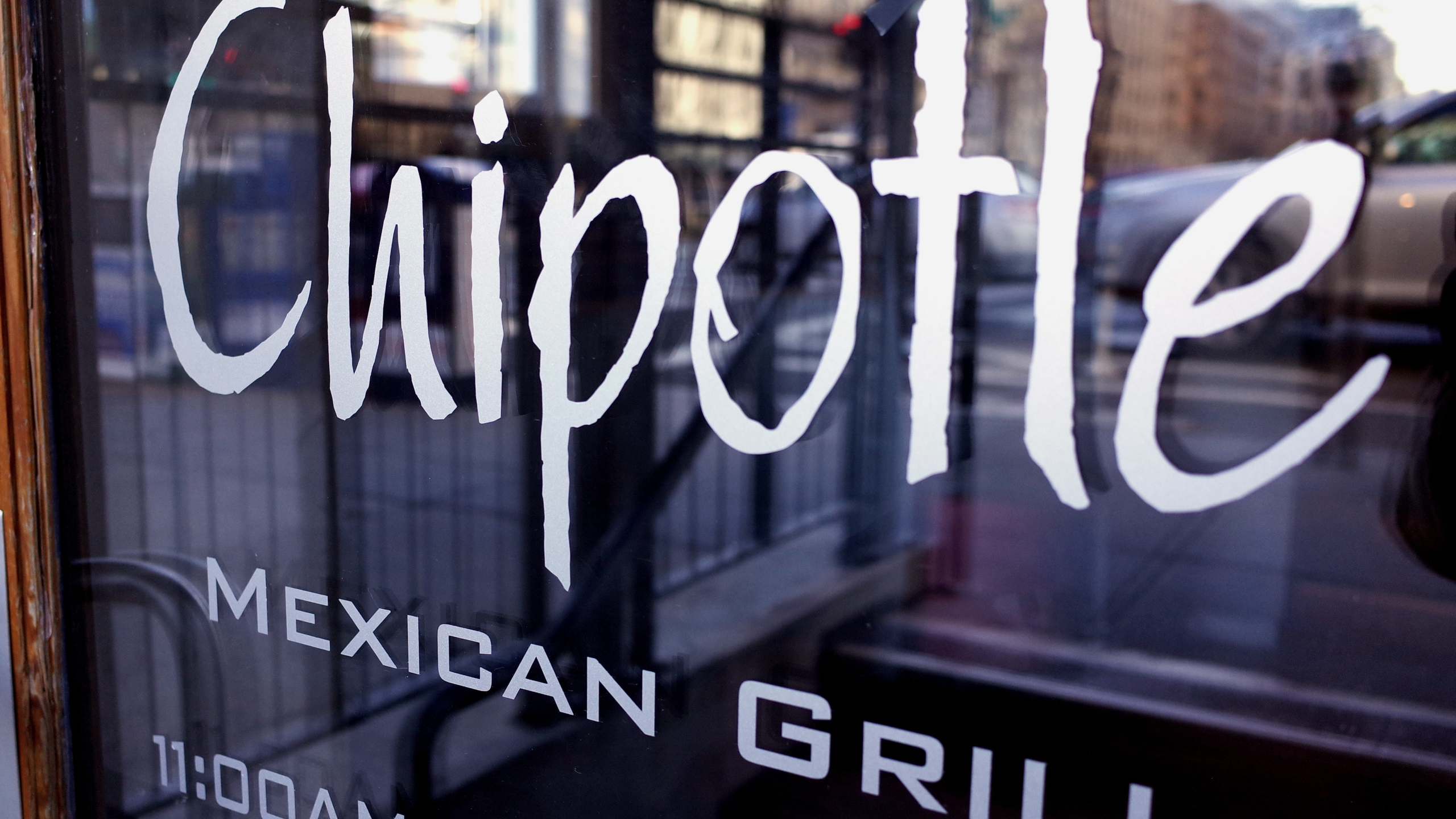 The Chipotle logo is seen on the door of one of its restaurants on Jan. 11, 2015, in Washington, D.C. (Credit: MANDEL NGAN/AFP/Getty Images)