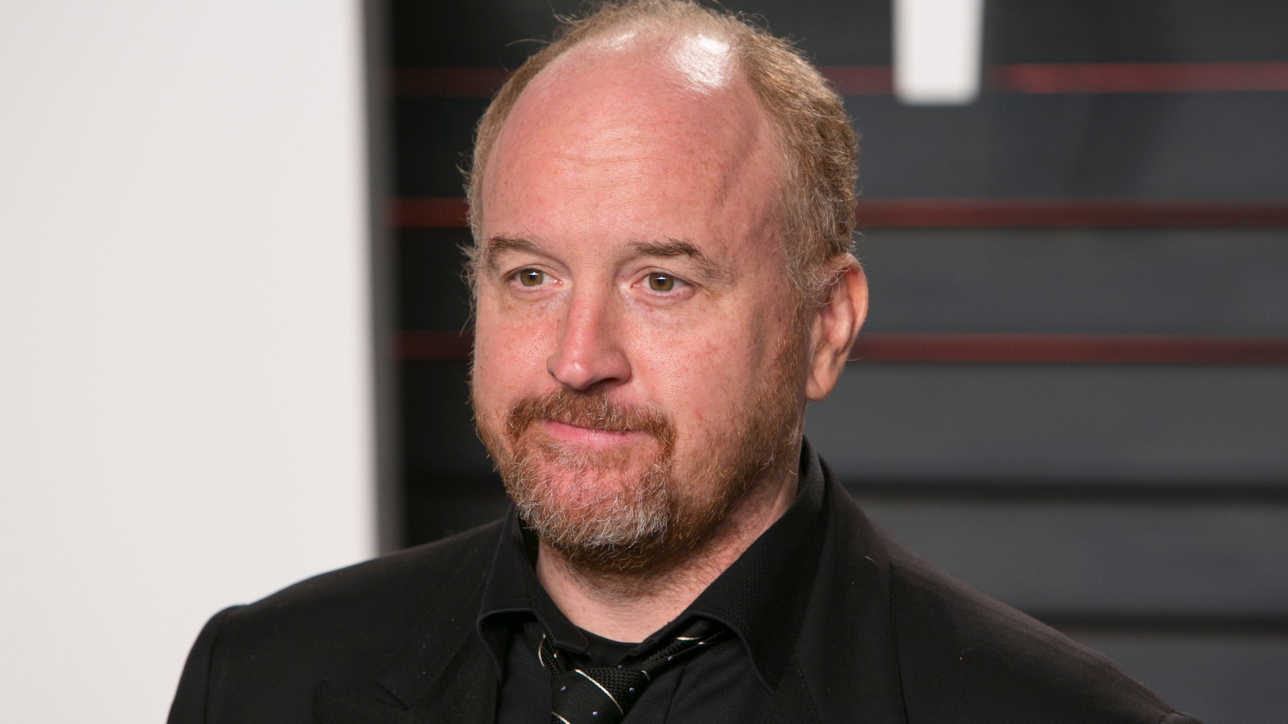 Comedian Louis C.K. poses as he arrives to the 2016 Vanity Fair Oscar Party in Beverly Hills on Feb. 28, 2016. (Credit: Adrian Sanchez Gonzalez/AFP/Getty Images)