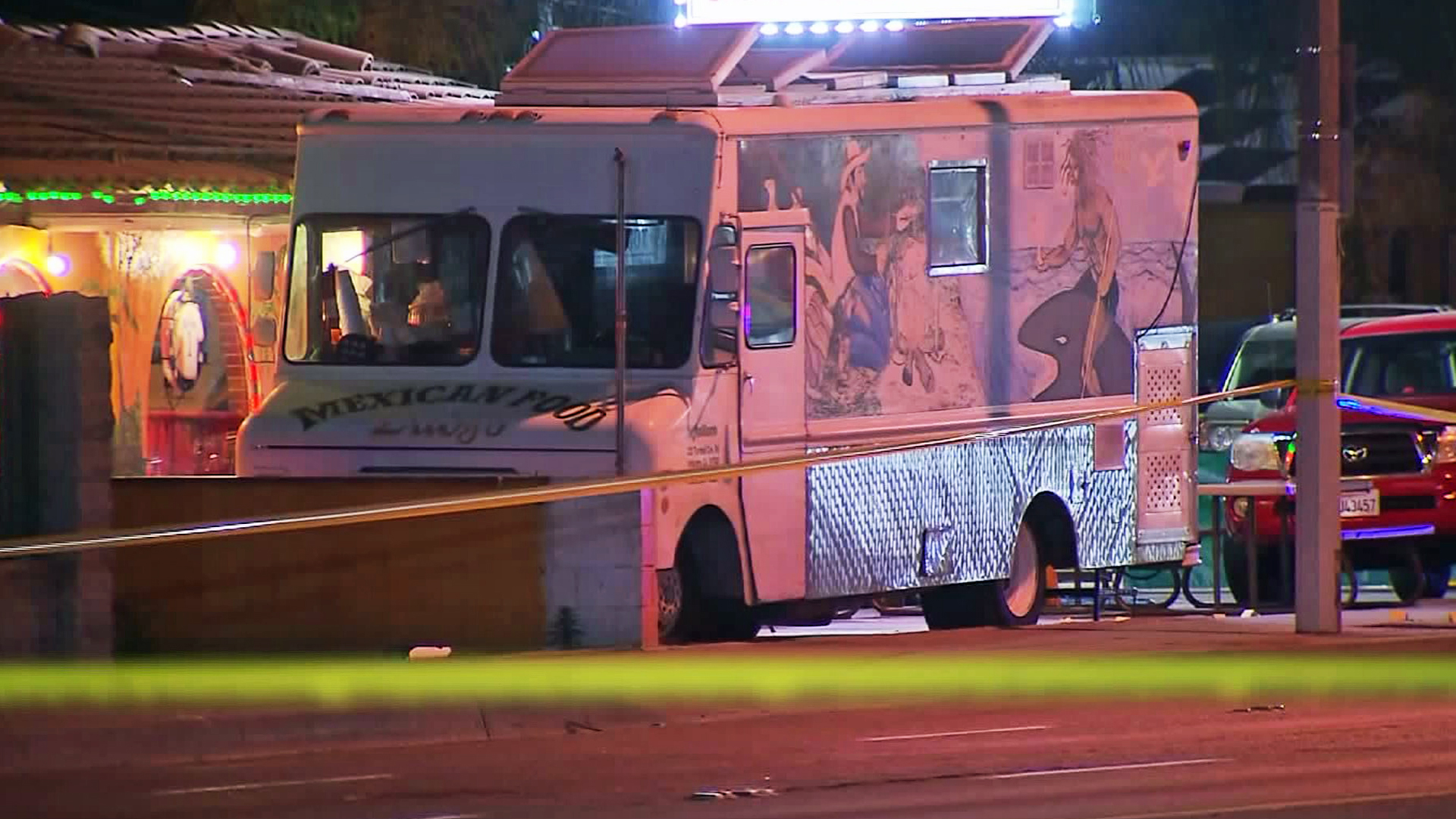A taco truck is seen in the parking lot where a fatal shootout took place in Bassett on April 19, 2016. (Credit: KTLA)