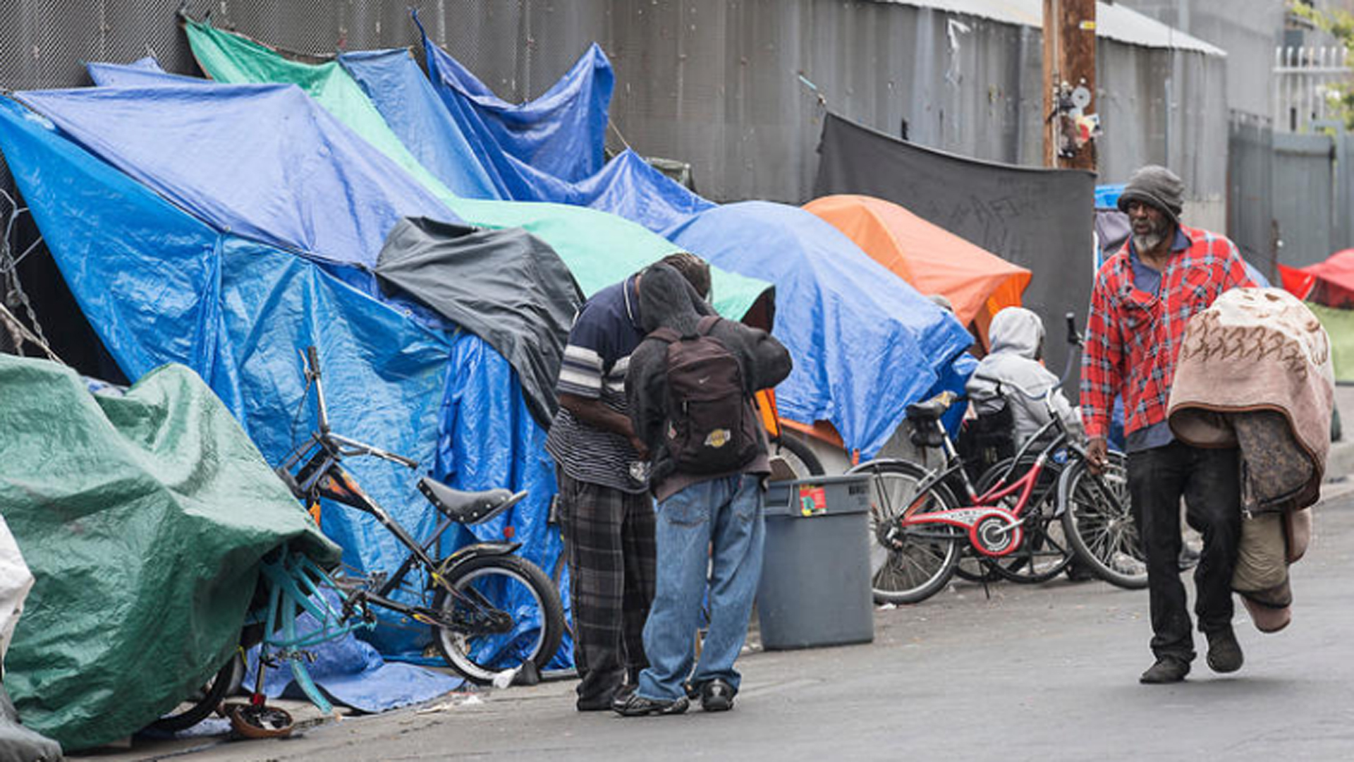 Homeless people set up tarps and tents in downtown Los Angeles' Skid Row in May 2016. (Credit: Brian van der Brug / Los Angeles Times)