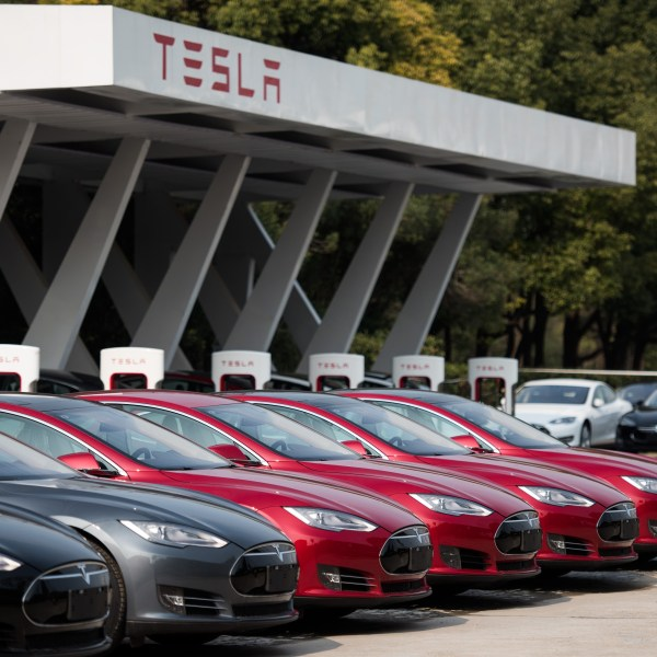 Tesla Model S vehicles are parked outside a car dealership in Shanghai on March 17, 2015. (Credit: JOHANNES EISELE/AFP/Getty Images)