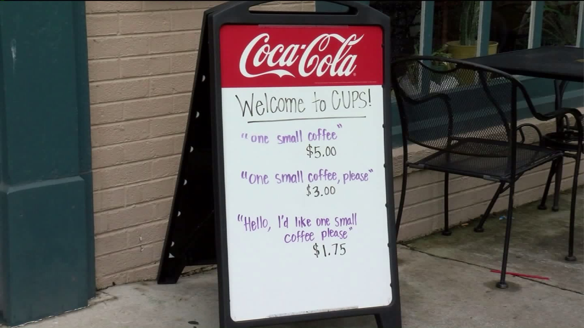 A sign outside CUPS Coffee & Tea in Roanoke, Virginia, shows varying prices for a cup of coffee depending on how it's ordered. (Credit: WDBJ)
