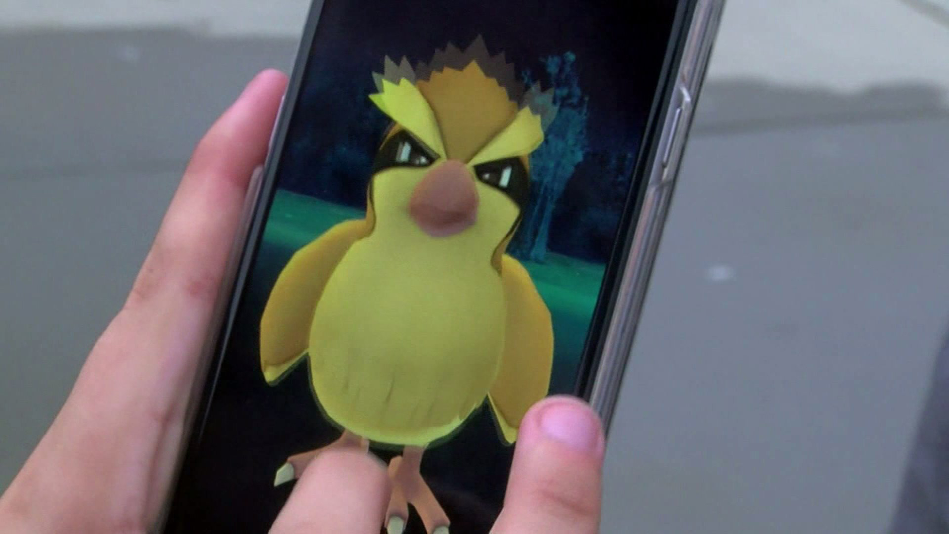 "In this file photo, a smartphone user is seen playing ""Pokemon Go."" (Credit: KTLA)"