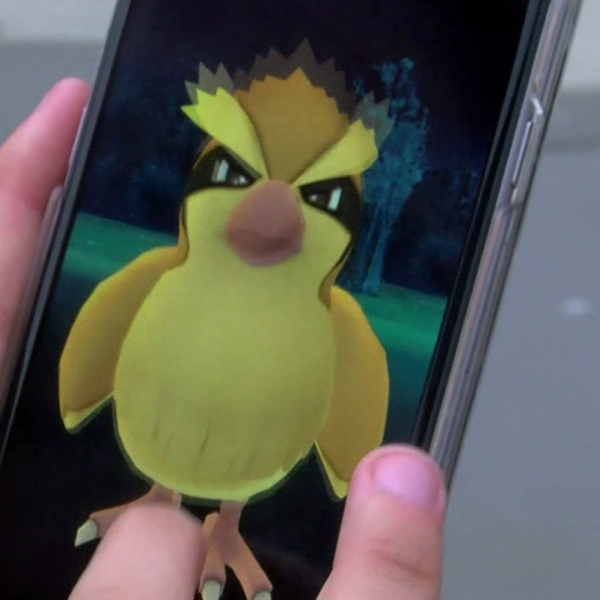 """In this file photo, a smartphone user is seen playing """"Pokemon Go."""" (Credit: KTLA)"""