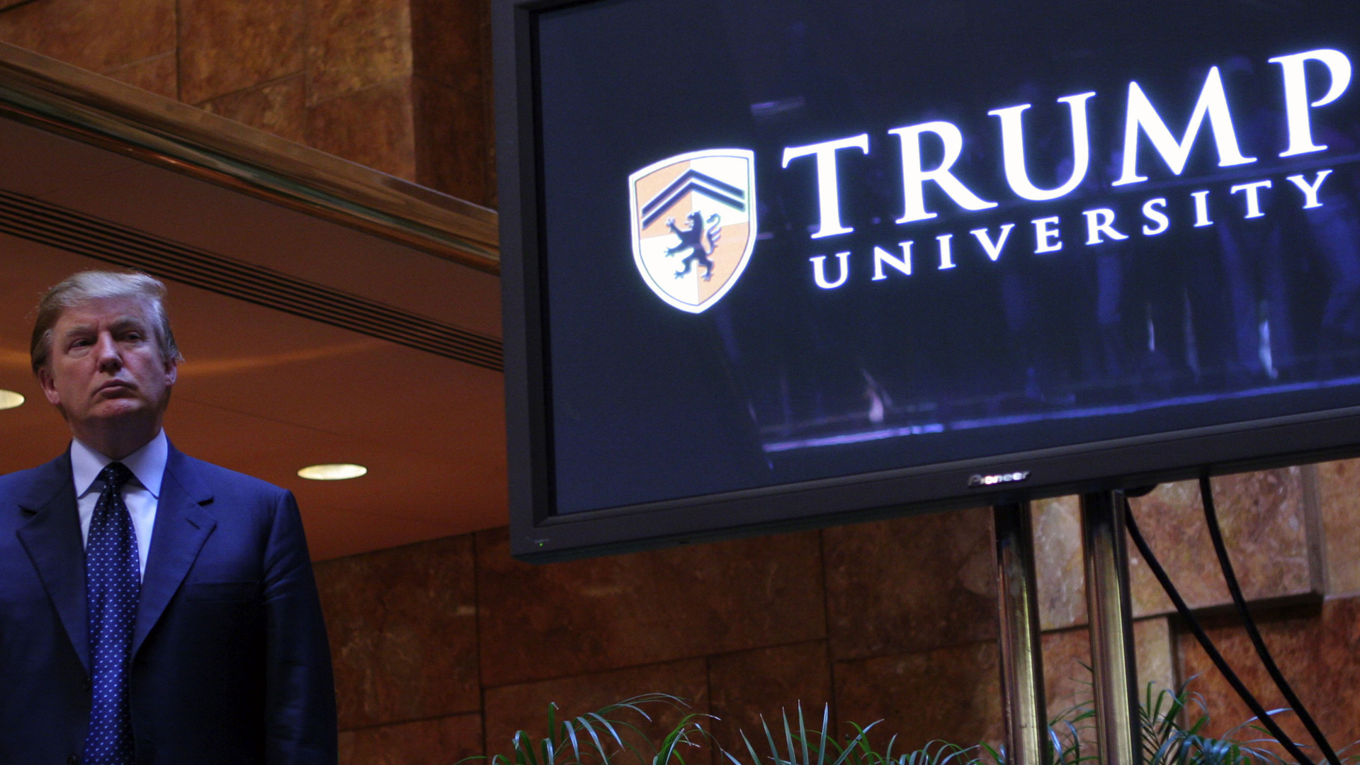 Donald Trump holds a media conference announcing the establishment of Trump University May 23, 2005 in New York City. (Credit: Thos Robinson/Getty Images)