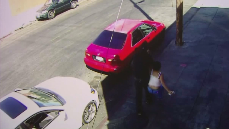 Surveillance video released by the LAPD shows a woman being dragged from a convenient store in Exposition Park on Sept. 28, 2016.
