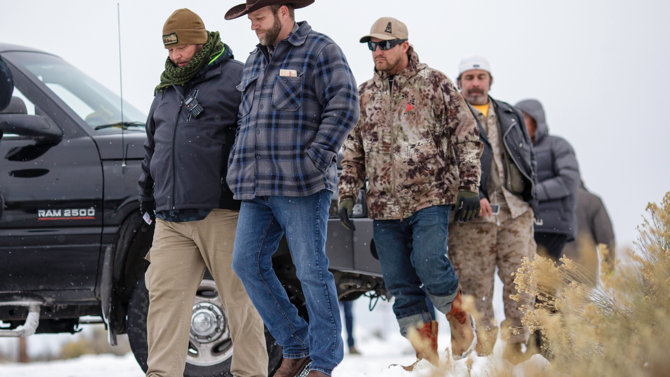 Ammon Bundy, in front, leader of an armed anti-government militia, returns to the Malheur National Wildlife Refuge Headquarters near Burns, Oregon Jan. 5, 2016, following a news conference. (Rob Kerr/AFP/Getty Images)