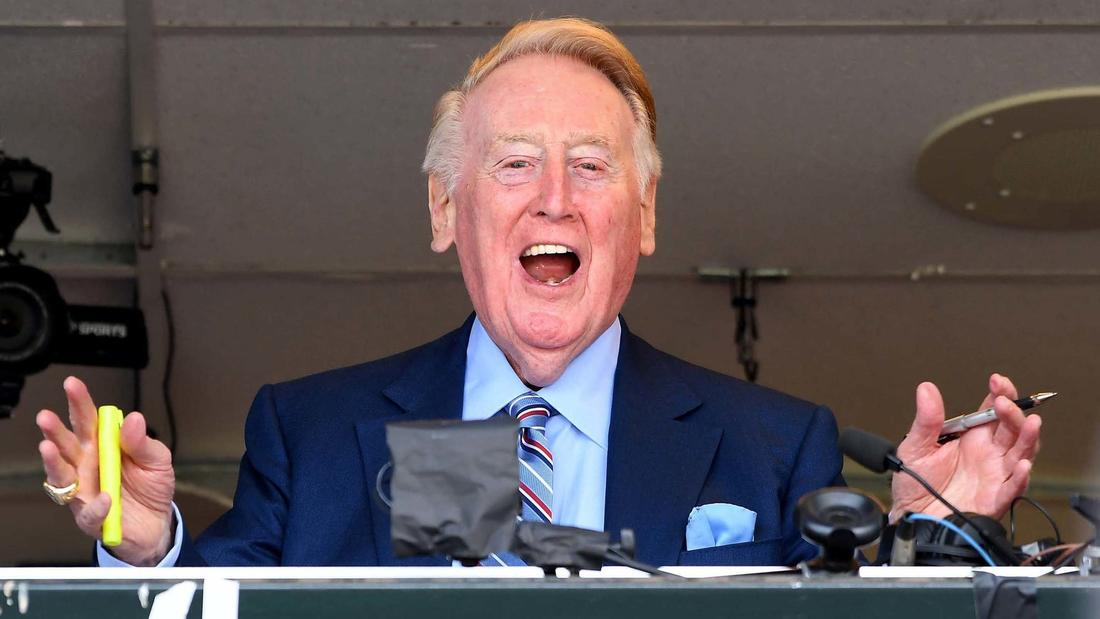 Dodgers broadcast announcer Vin Scully waves to the crowd during his last broadcast. (Wally Skalij / Los Angeles Times)