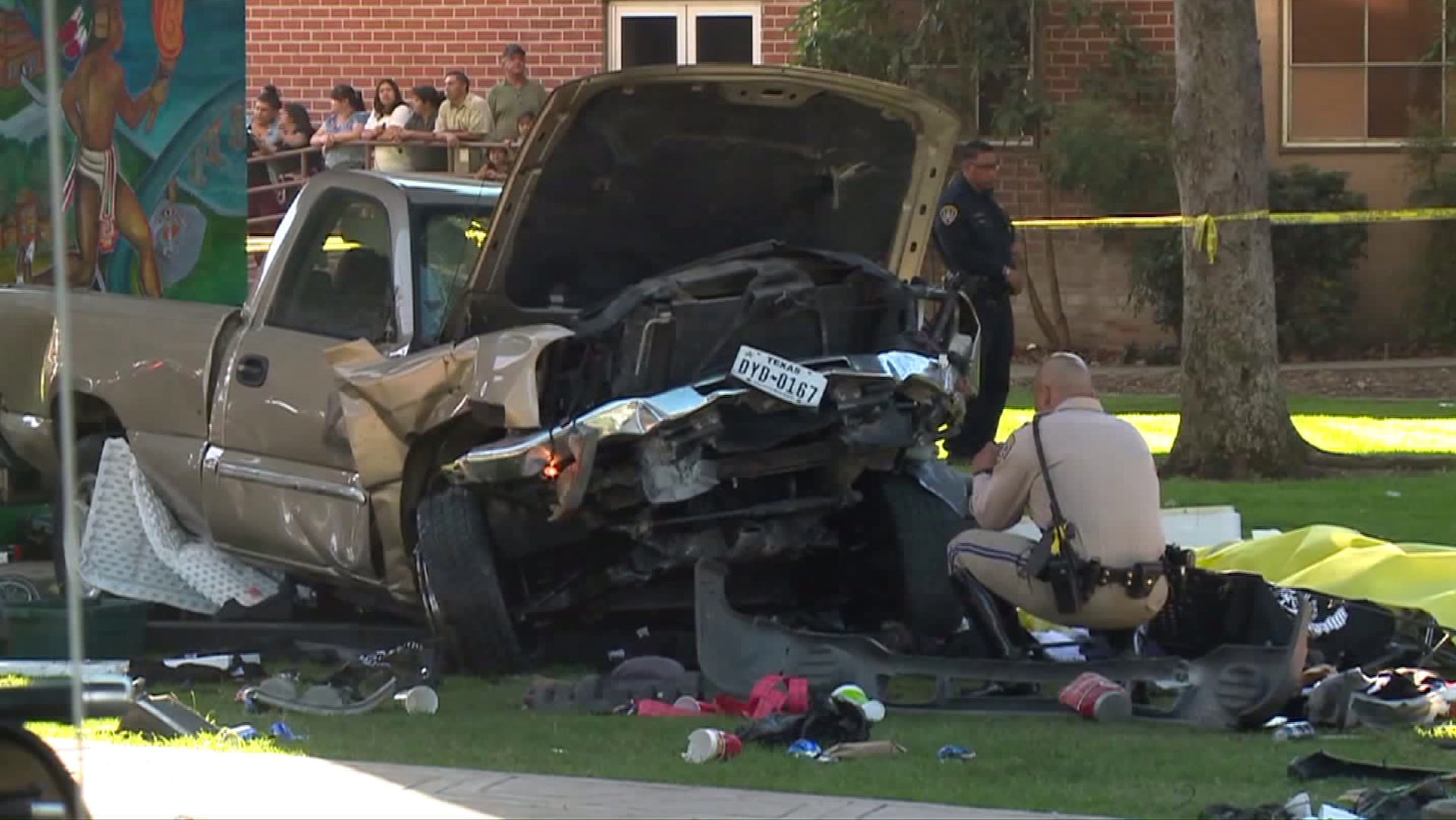 The pickup driven by a Navy technician landed at Chicano Park after it flew off a ramp to the San Diego Coronado Bridge, killing four people. (Credit: KTLA)