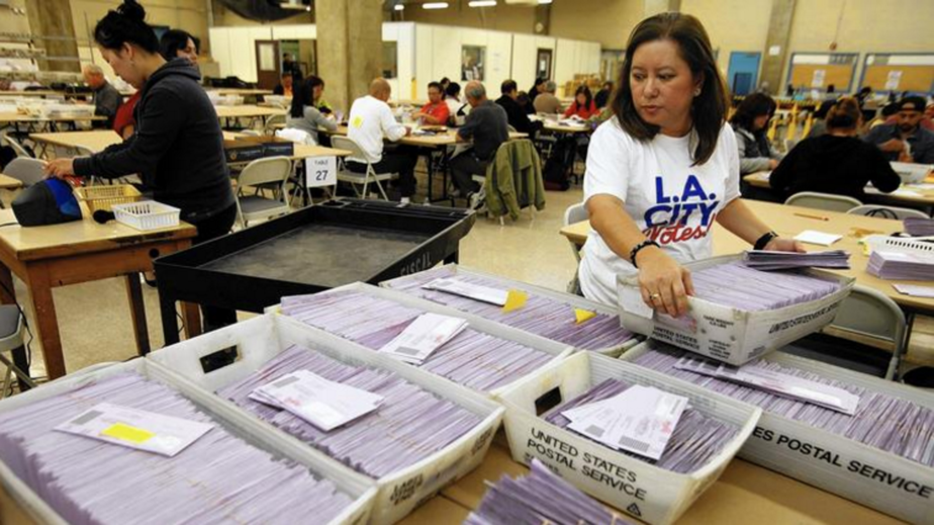 L.A. officials sort uncounted ballots from the Los Angeles primary election in 2015. (Credit: Genaro Molina / Los Angeles Times)