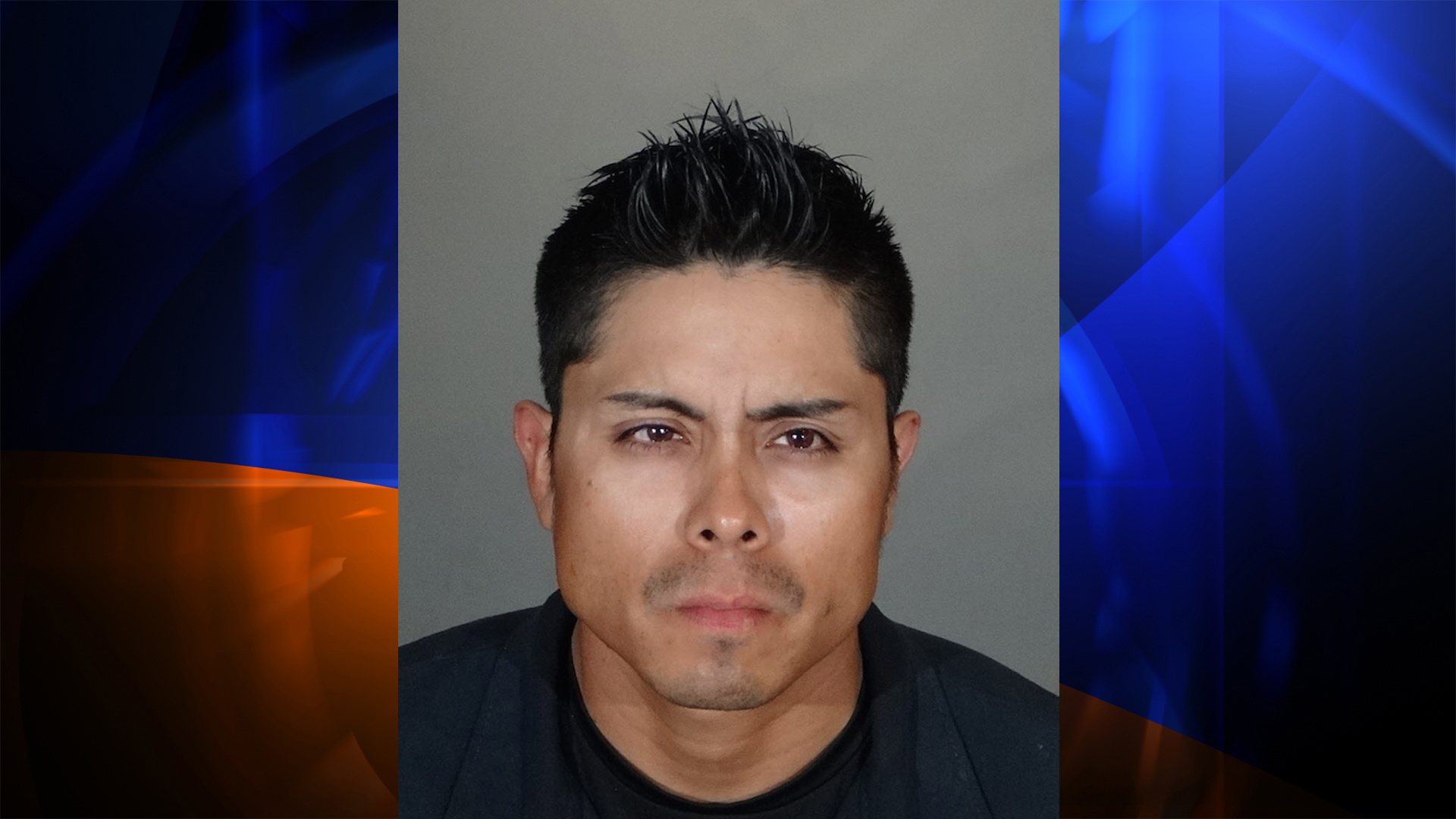 Samuel Alexander Vasquez is seen in a booking photo released by LAPD.