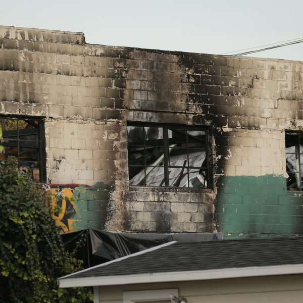 The burnt exterior of a warehouse in which a fire claimed the lives of at least thirty-three people is seen on December 4, 2016 in Oakland, California. (Elijah Nouvelage/Getty Images)
