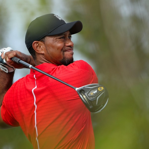 Tiger Woods hits a tee shot on the 11th hole during the final round of the Hero World Challenge on Dec. 4, 2016 in Nassau, Bahamas. (Credit: Christian Petersen/Getty Images)