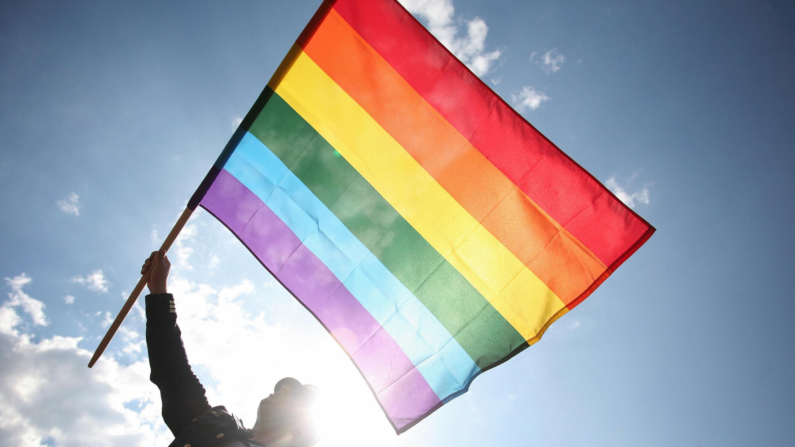 A person wave a rainbow flag as he takes part to the Gay Pride parade on June 7, 2008 in Warsaw. (Wojtek Radwanski/AFP/Getty Images)