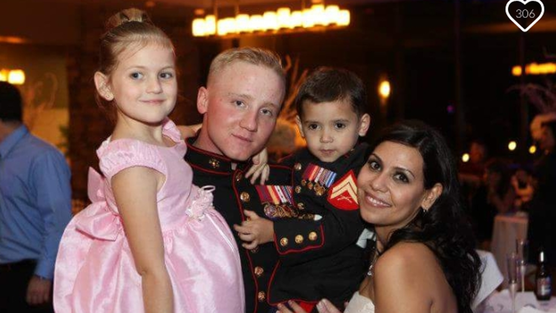 Officer Doe is shown with his family in a photo posted to a GoFundMe page.