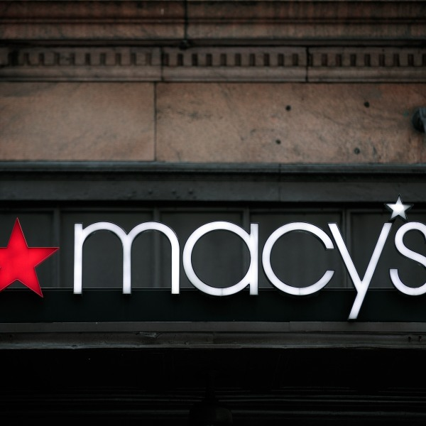 The Macy's sign hangs over its flagship store in Herald Square, August 11, 2016 in New York City. On Thursday, Macy's announced plans to close 100 stores nationwide. (Photo by Drew Angerer/Getty Images)
