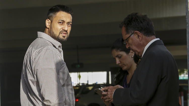 Syed Raheel Farook, left, is released on bail at the Riverside Federal Courthouse in April 2016. (Credit: Irfan Khan / Los Angeles Times)