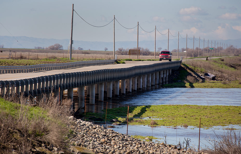West Washington Road where it crosses the Eastside Bypass, a constructed floodway for the San Joaquin River, is shown in a state Department of Water Resources photo.