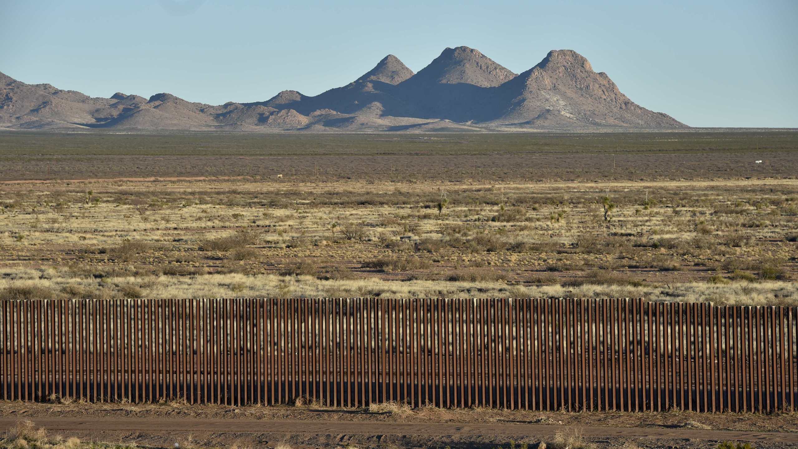 View of the metal fence between U.S. and Mexico taken in Puerto Palomas, Chihuahua state, on Feb. 19, 2017. (Credit: Yuri Cortez / AFP / Getty Images)
