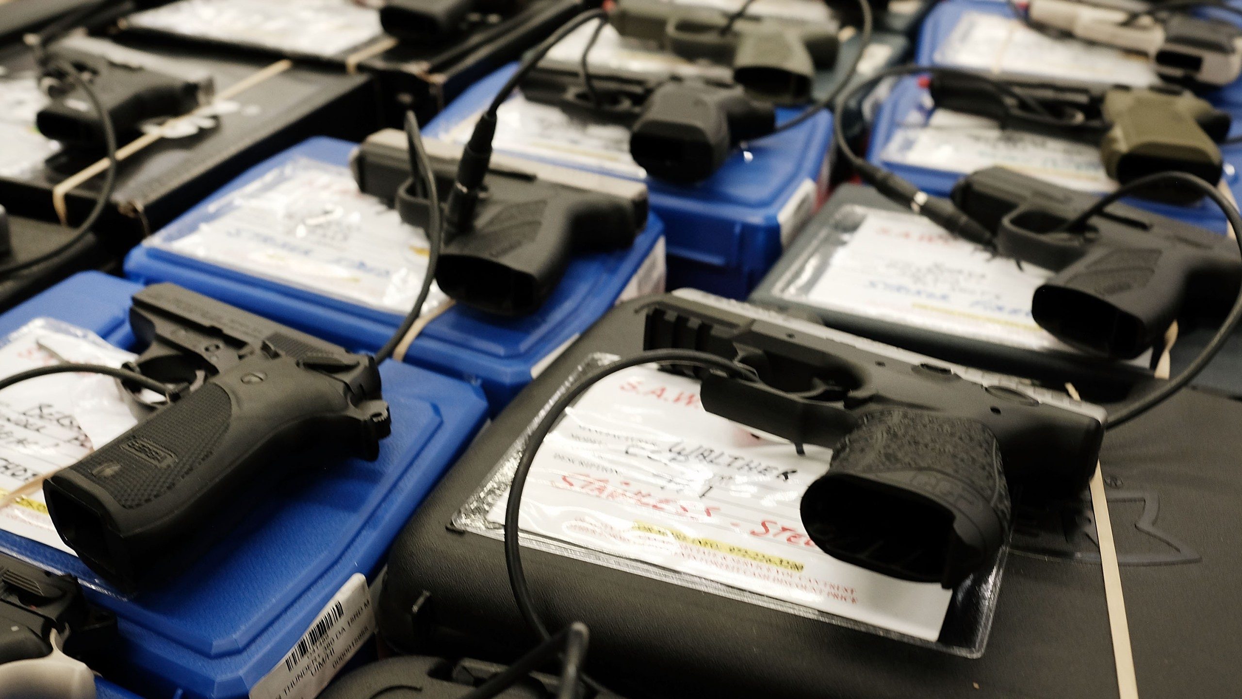 Guns sit for sale at a gun show where thousands of different weapons are displayed for sale on July 10, 2016 in Fort Worth, Texas. (Credit: Spencer Platt/Getty Images)