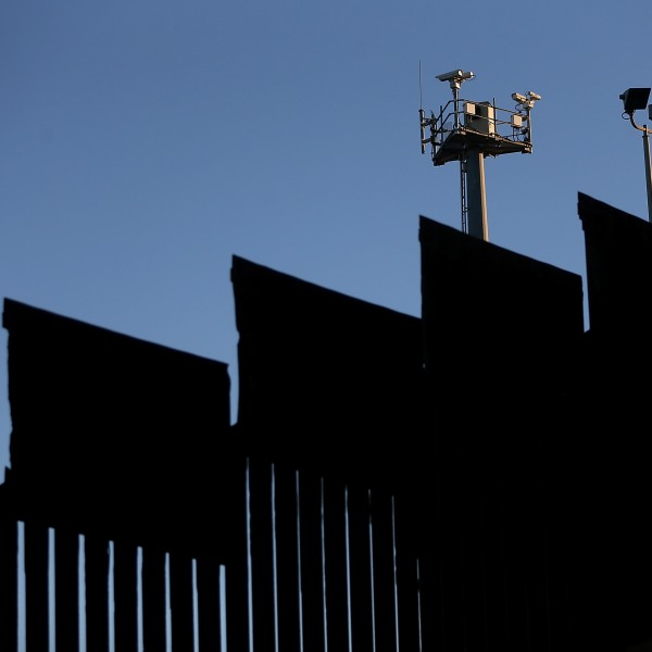 Surveillance cameras stand above the U.S.-Mexican border fence at Playas de Tijuana on Jan. 27, 2017, in Tijuana, Mexico. (Credit: Justin Sullivan/Getty Images)